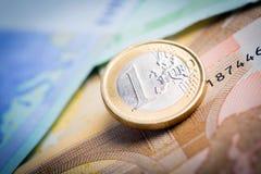 Closeup of euro banknotes and coins Royalty Free Stock Photos