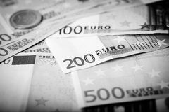 Closeup of euro banknotes and coins Stock Photo