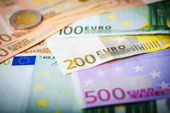 Closeup of euro banknotes and coins Royalty Free Stock Photo