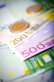 Closeup of euro banknotes and coins Stock Photos