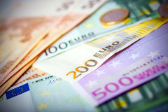 Closeup of euro banknotes and coins Stock Images