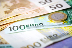 Closeup of euro banknotes and coins Stock Photography