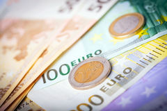 Closeup of euro banknotes and coins Royalty Free Stock Images