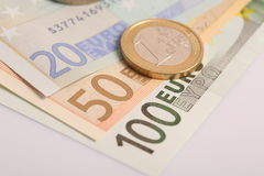 Closeup of euro banknotes and coins Royalty Free Stock Photography