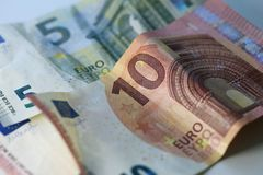 Closeup of 5 and 10 Euro Banknotes. 5 and 10 euro banknotes in a closeup photo taken with a macro lens. Color image. Photographed in Kuopio, Finland during royalty free stock image