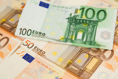 Closeup of euro banknotes. Closeup of one hundred euro banknote on money background Royalty Free Stock Photography