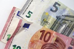 Closeup of 5 and 10 Euro Banknotes. 5 and 10 euro banknotes in a closeup photo taken with a macro lens. Color image. Photographed in Kuopio, Finland during stock photos