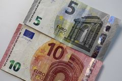 Closeup of 5 and 10 Euro Banknotes. 5 and 10 euro banknotes in a closeup photo taken with a macro lens. Color image. Photographed in Kuopio, Finland during stock photography