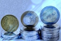 Closeup of eurocoins stand on a pile of coins. royalty free illustration