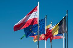 European flags on blue sky background. Closeup of european flags on blue sky background stock photos