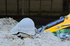 Closeup of excavator bucket on dusty ground Royalty Free Stock Image
