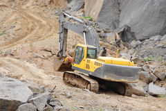 Closeup of an excavator moving on top level Royalty Free Stock Image