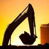 Closeup excavator at sunset Royalty Free Stock Photos