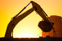 Closeup excavator at sunset Royalty Free Stock Images