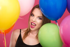 Closeup of excited glamour young female with colorful balloons Royalty Free Stock Photography
