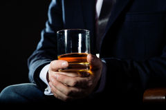 Closeup of executive holding  whiskey to Royalty Free Stock Image