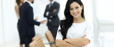 Closeup. Executive woman in the office. On the background of colleagues stock image