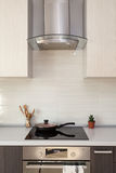 Closeup of exhaust hood and ceramic cooking plate in the new modern kitchen. stock image
