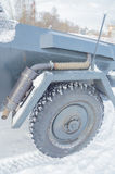 Closeup of exhaust pipe, hood and wheel German armored personnel carrier Stock Image