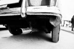 Closeup exhaust pipe of old vintage car. Black and white photo Royalty Free Stock Image