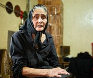 Expressive rural old woman indoor Royalty Free Stock Images