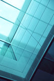 Closeup of exterior of blue glass residential building Royalty Free Stock Images
