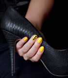 Closeup of a extravagant yellow nails. Close-up of a stiletto with yellow fashion nails royalty free stock images