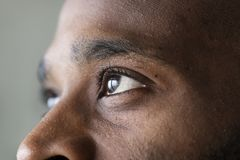 Closeup of an eye of a black man royalty free stock photography