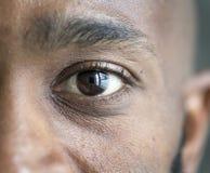 Closeup of an eye of a black man stock photo