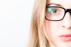 Closeup of and eye of blonde woman with black glasses Stock Photos