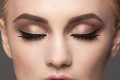 Closeup of eye makeup stock images