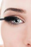 Closeup with eye and mascara wand Royalty Free Stock Image