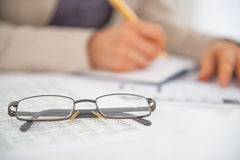 Closeup on eyeglasses on table Royalty Free Stock Photos