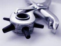 Closeup Eyelet Tool. Closeup of a Eyelet tool, with blue tint Royalty Free Stock Image