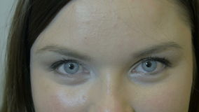 Closeup of eyes of different persons - doctors looking at camera stock video