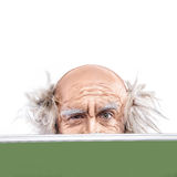 Closeup eyes of a madman bald oldman by the school board Stock Image