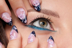 Closeup eyes make-up zone. Nail art. Finger.  Pink and blue color. High resolution Royalty Free Stock Photography
