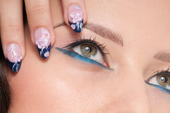 Closeup eyes make-up zone. Nail art Stock Image