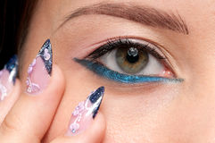 Closeup eyes make-up zone. Nail art Stock Photos