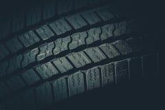 Closeup för däckmönster för bilgummihjul arkivbild