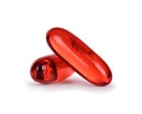 Closeup för två preventivpillerar som isoleras på vit royaltyfria bilder