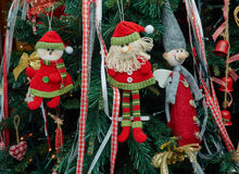 Closeup fabric decorative items hung up Christmas tree Royalty Free Stock Photos