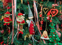 Closeup fabric decorative items hung up Christmas tree Royalty Free Stock Photography