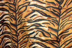 Closeup fabric pattern of royal tiger or Bengal tiger, in black brown orange and white. royalty free stock photo