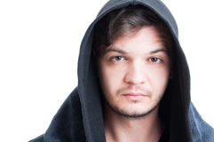 Closeup face of attractive man with black hood Stock Images