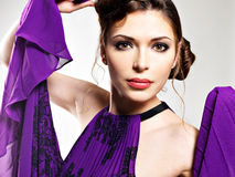 Closeup face of the beautiful fashion woman in purple dress Royalty Free Stock Images