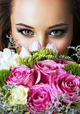 Closeup face of beautiful  girl with flowers. Royalty Free Stock Photo
