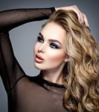 Beautiful blonde girl with  makeup in style smoky eyes. Stock Photography