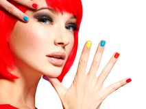 Closeup face of a beautiful  girl with  multicolor nails. Stock Images
