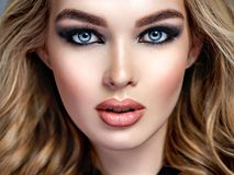 Closeup face of a beautiful woman with blue eyes Royalty Free Stock Photo